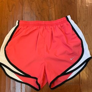 Pink and white nike running shorts